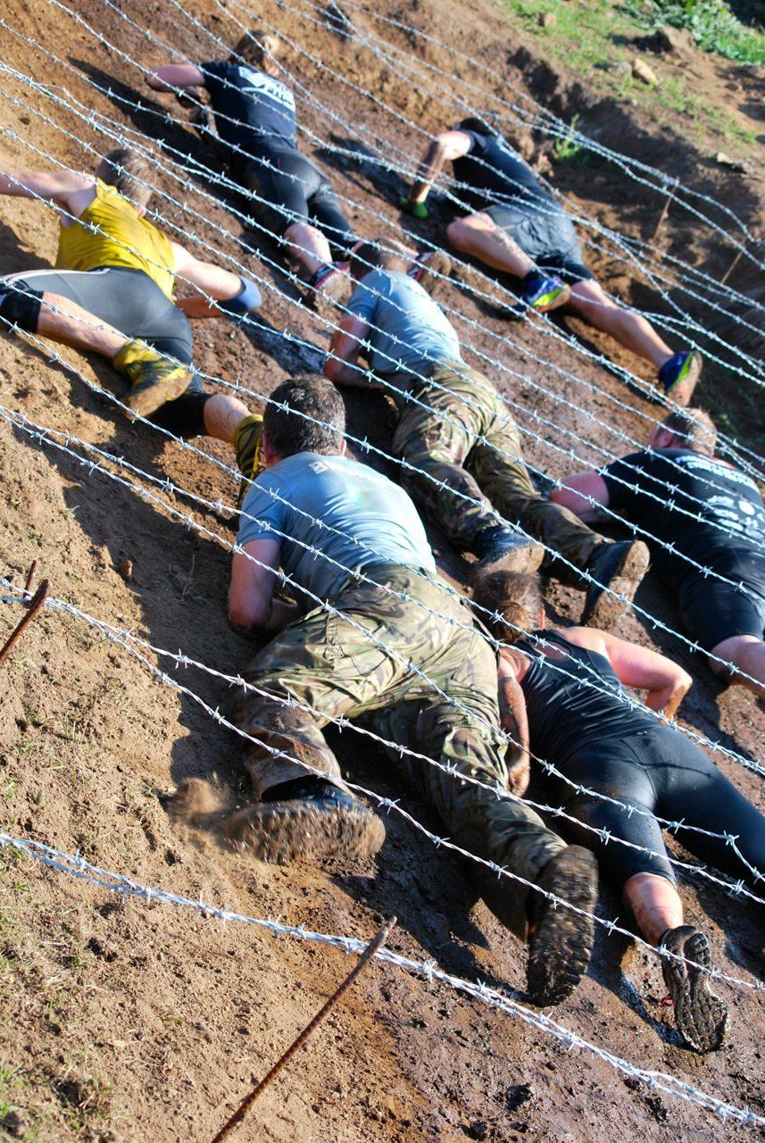 Athletes crawl under barbed wire at Tuff Enuff 2014