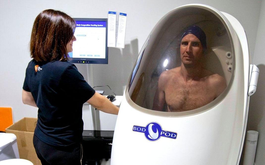 Tim Heming in the body composition chamber at GSK