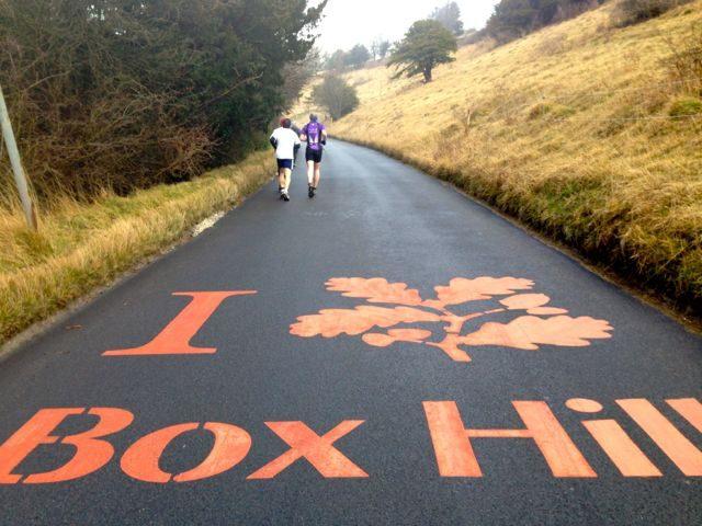 Triathletes running up Box Hill