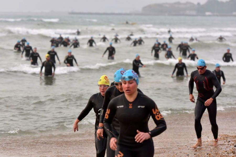 Triathletes leaving the swim at Challenge Weymouth