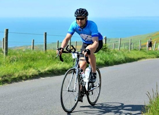 Luke Tyburski cycling to the coast