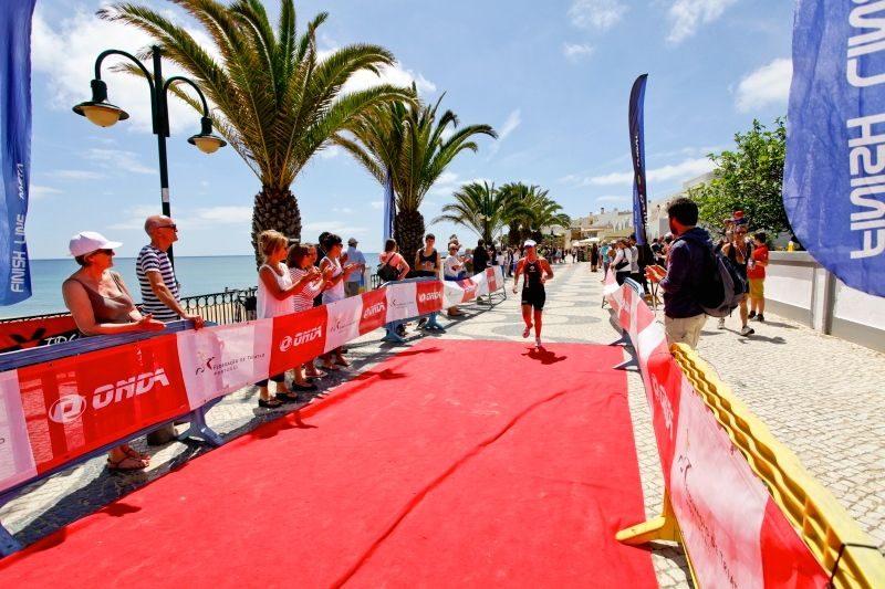 Triathlete finishing the run at Martinhal Triathlon in Algarve, Portugal