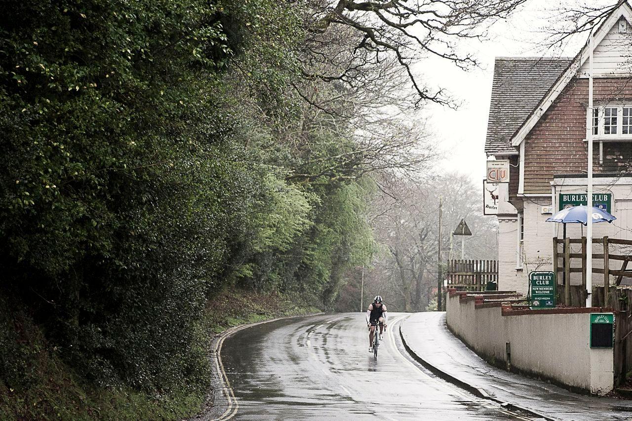Triathlete cycling down a hill