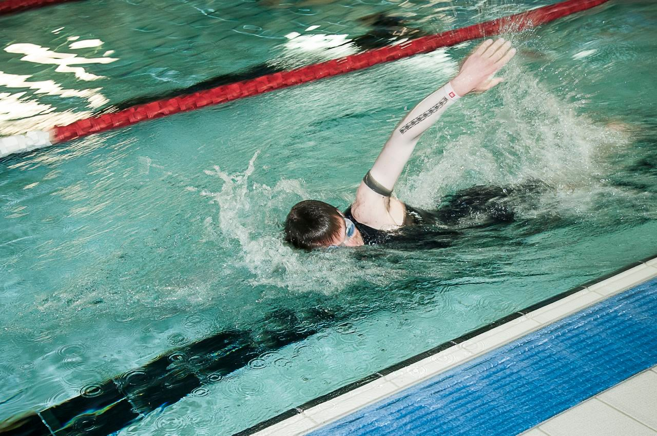 Swimmer working on his technique