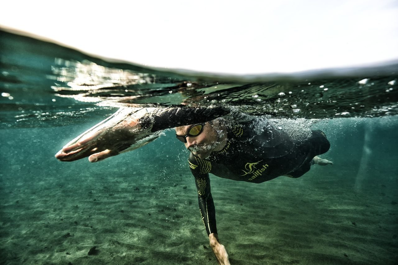 Triathlete swimming in open water
