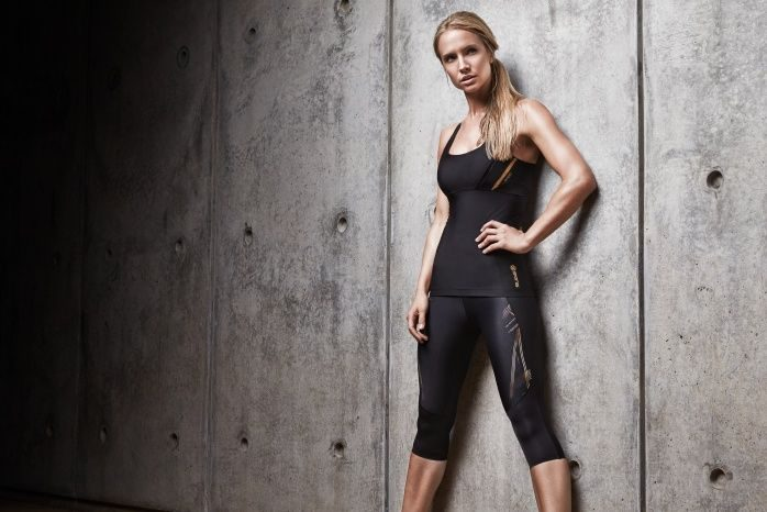 Female athlete wearing new Skins A400 compression wear