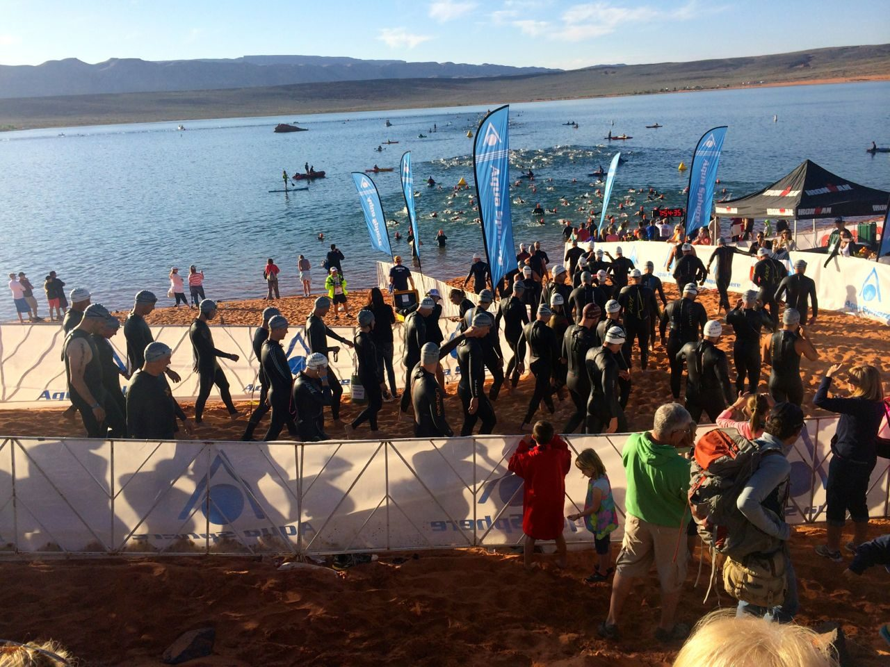 Athletes enter the water at Ironman 70.3 St. George 2015