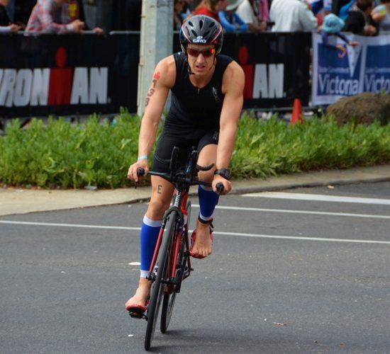 Tim Ballintine cycling in an Ironman race