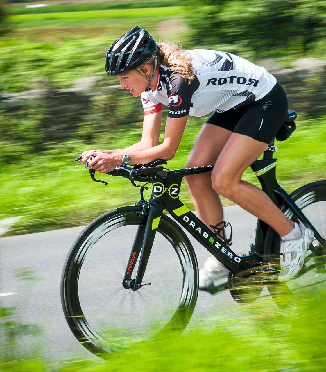 Female triathlete in bike training