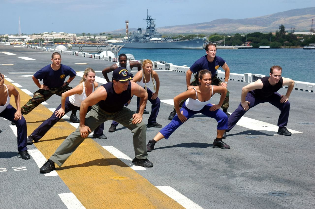 Athletes doing fitness exercises on a US navy ship