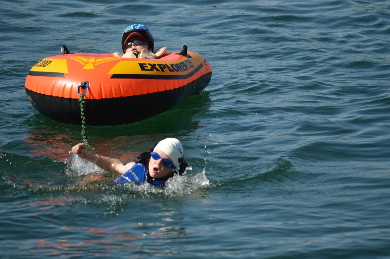 Noah and Lucas Aldrich swimming in the triathlon