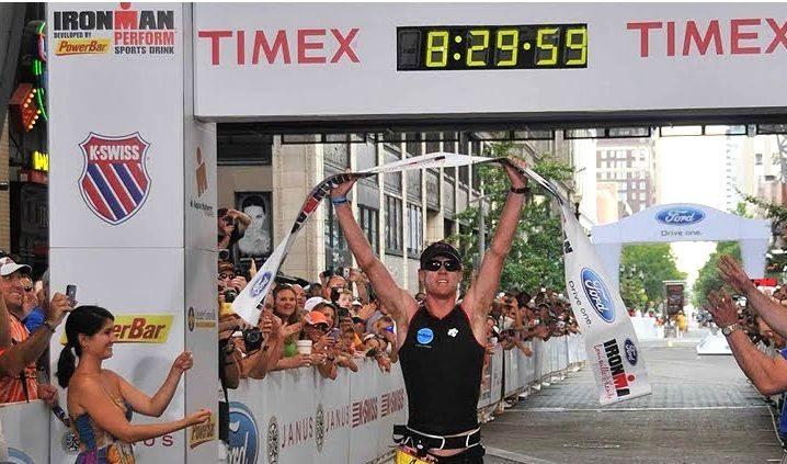 Paul Ambrose finishing a triathlon