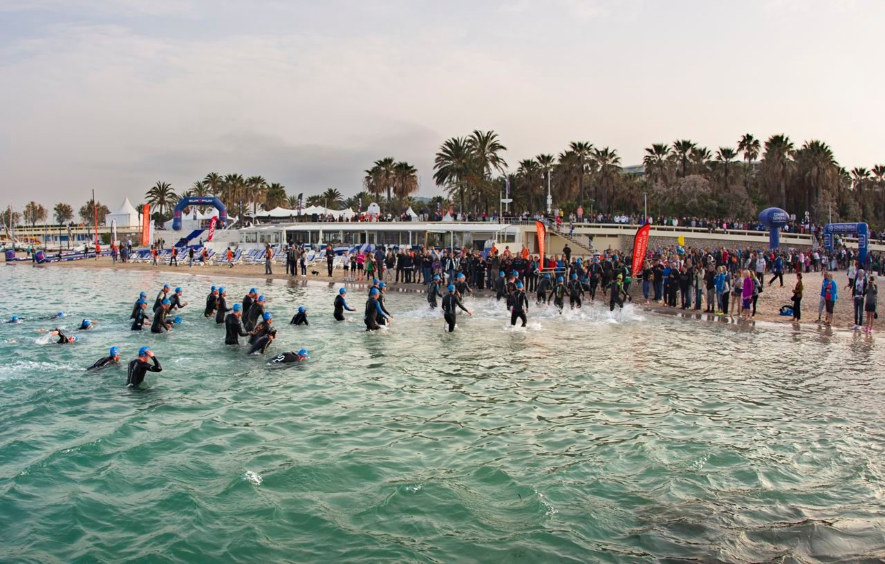 Athletes enter the water at Cannes International Triathlon