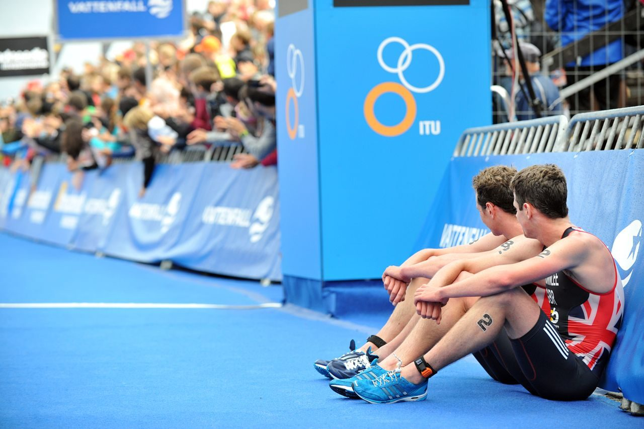 Alistair and Jonny Brownlee wait for rivals to cross the line