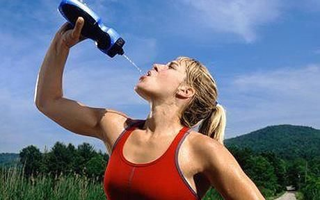 A female runner drinking