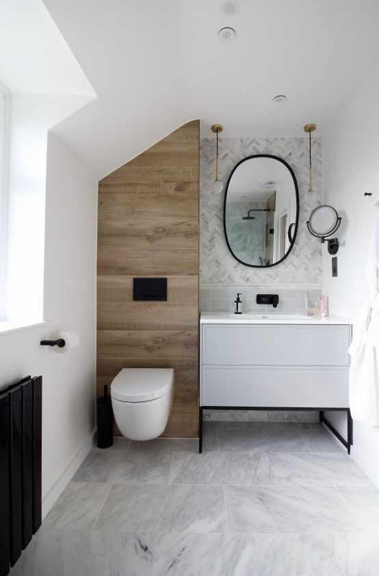 Bathroom renovation with wall mounted toilet and intuitive lighting