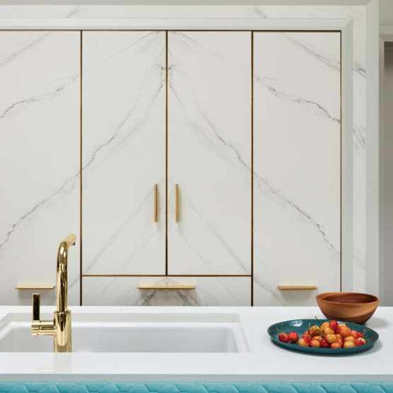 Frameless book-matched marble cupboard