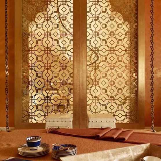 Gold Moroccan sliding doors for an international design Qatari home