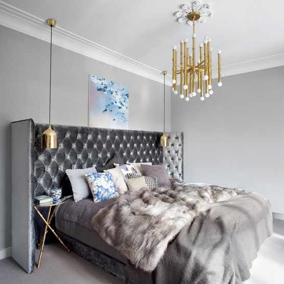 Luxury bedroom with fur throw and gold accents