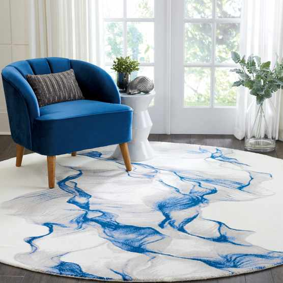 Round rug in light and airy square room