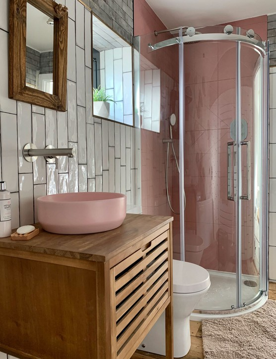 Pink bathroom sink and shower tiles