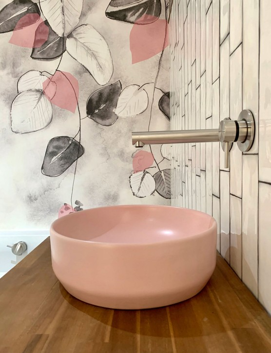 Pink wallpaper and sink