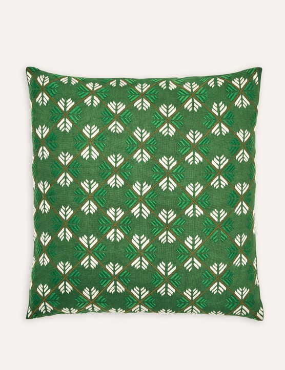 embroidered green cushion made by Afghan refugees in Pakistan