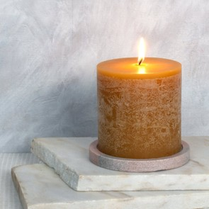 Candles in rich hues will add warmth as well as a cosy glow. Honey-scented pillar candle, from £18, Mint & May