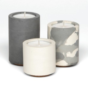 Try the industrial trend with textured concrete holders. Tealight trio, £35, Concrete & Wax