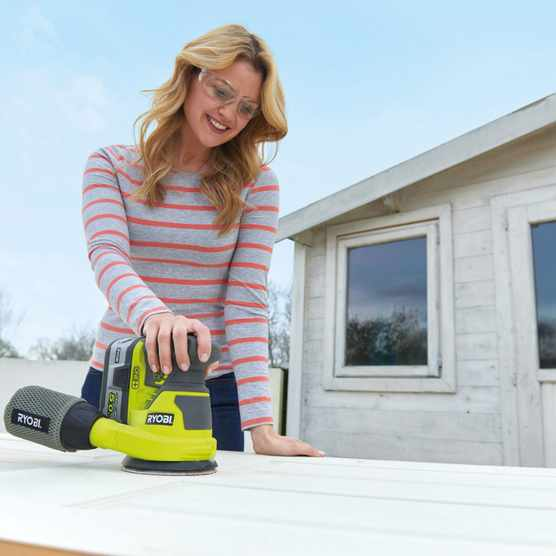 Woman using cordless sander power tool