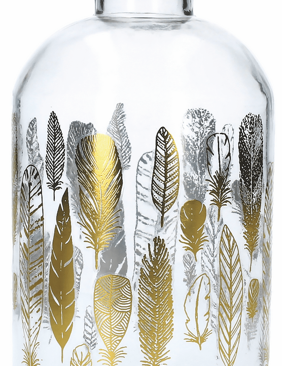 Add glitz with this glass bottle adorned with pretty painted golden feathers. £10 from Gisela Graham