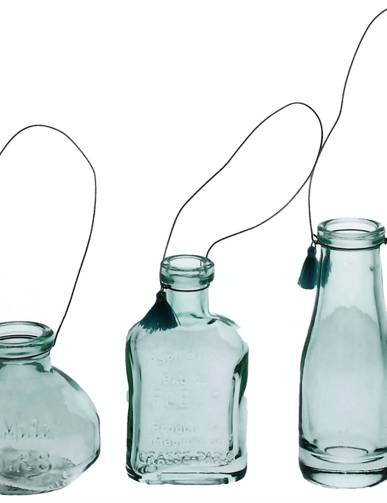 Display dainty blooms in this trio of petite, tasselled hanging bottle vases. £6.75 for three from The Contemporary Home