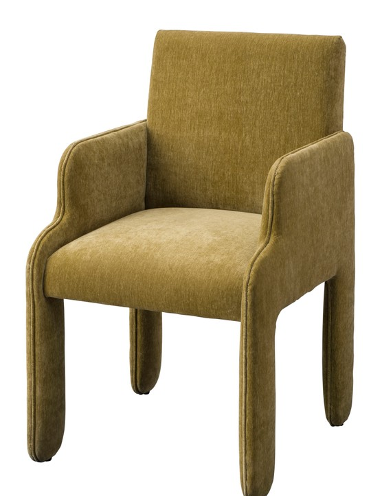 Plush velvet and elegant curves give this 60s-inspired Kiku armchair a luxe feel. £399 from  Atkin and Thyme