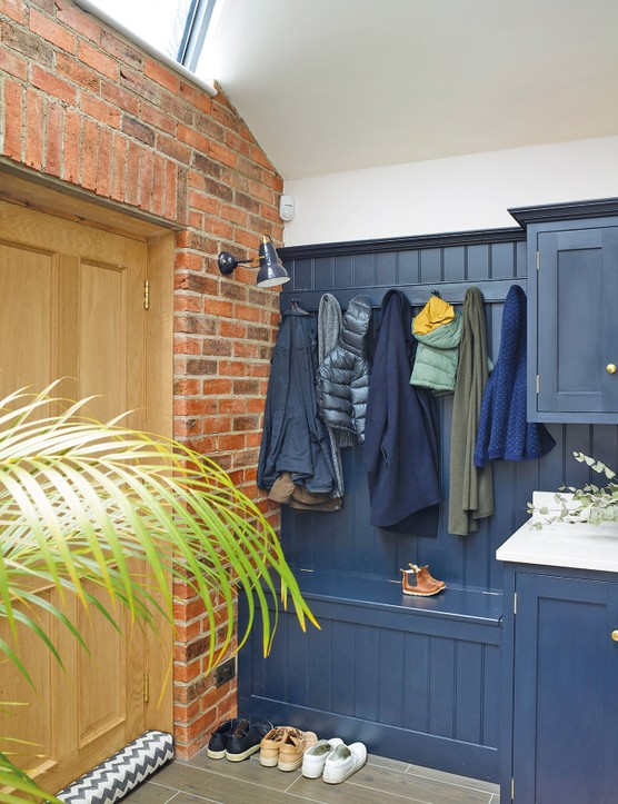 This boot room was inspired by the showroom at deVOL Kitchens. 'They had such a beautiful utility/pantry set-up when we visited,' says Sarah. Anglepoise wall lights from Heal's complement the Steve Hills Design cabinetry, painted in Railings by Farrow & Ball