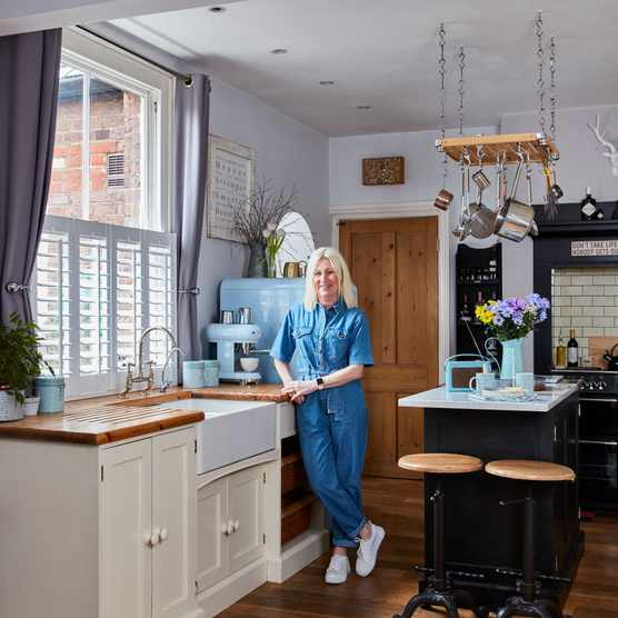 'It was always my dream to have a Smeg fridge in a cool colour in my kitchen! It's the first thing everyone notices in our open plan space,' she says. The metal ironwork bar stools are an Amazon find and the hanging pan rack came from eBay. 'We sanded back the worktop to revive the wooden surface and we make sure we oil it frequently to keep it in top condition'