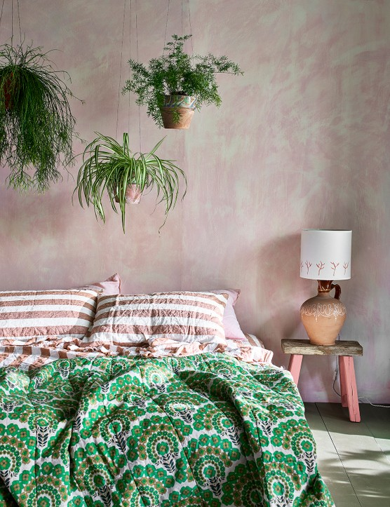 Hang plants above your bed to make a feature. Image credit: Annie Sloan