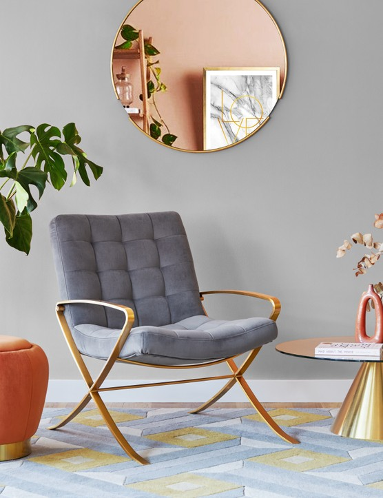 If your grey walls are feeling flat, bring your room to life with copper accessories and some fresh green houseplants. Image credit: Cult Furniture