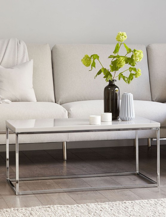 If you love contemporary design, try pairing a light grey backdrop with a white leather sofa for a sophisticated feel. Image credit: Danetti