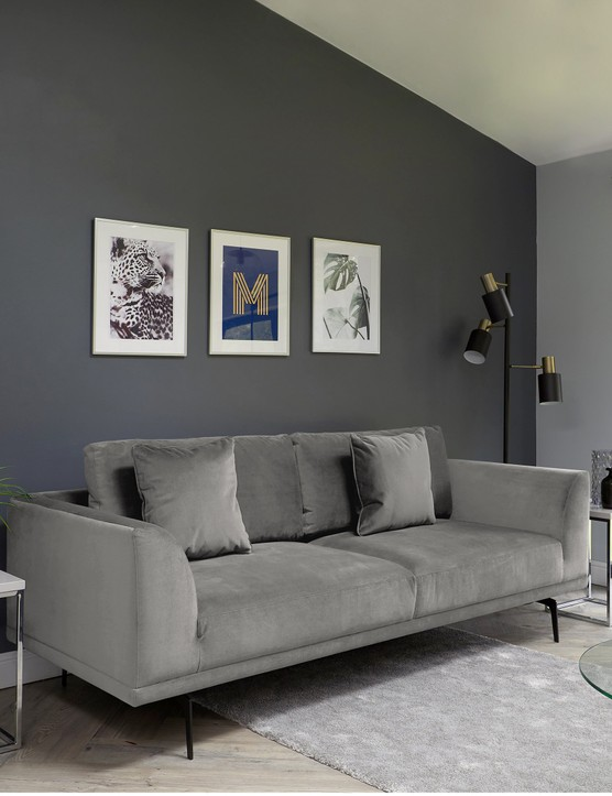 Charcoal grey doesn't have to feel dark - break it up with some light and bright artwork! Image credit: Danetti