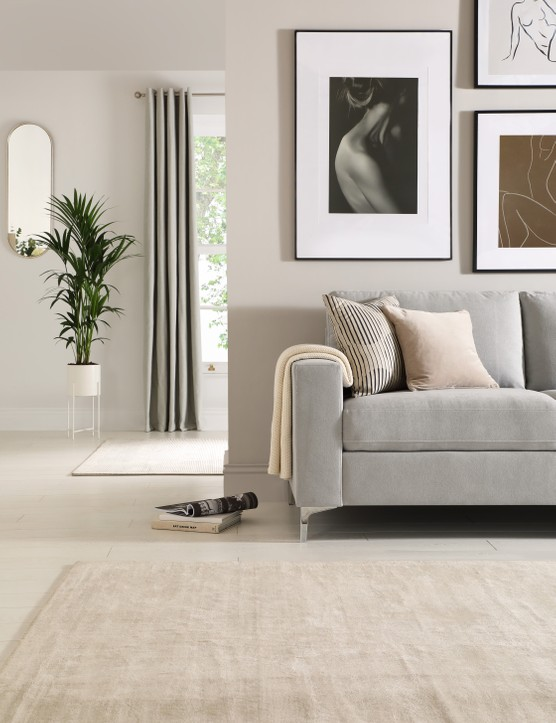Grey is a great colour choice if you're a fan of minimalist interiors, just be sure to keep your space looking warm and inviting with layered soft furnishings and artwork! Image credit: Furniture and Choice