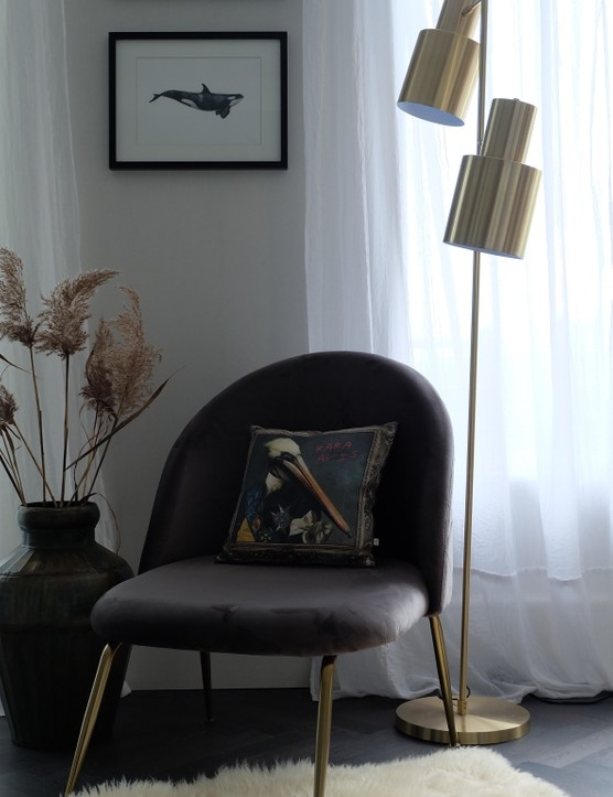Charcoal grey furniture looks great next to brass and gold fixtures. Image credit: Cult Furniture