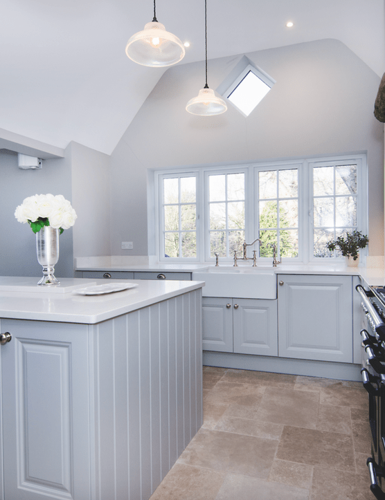The Pale Grey finish of this traditional Shaker Gainsborough cabinetry from Mereway's Town & Country collection helps distribute light throughout this kitchen extension, and enhance the sense of openness. Kitchen prices start from £14,000