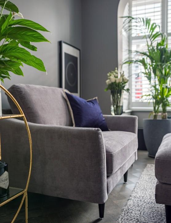 Green houseplants will keep a grey room looking fresh. Image credit: Snug Sofa