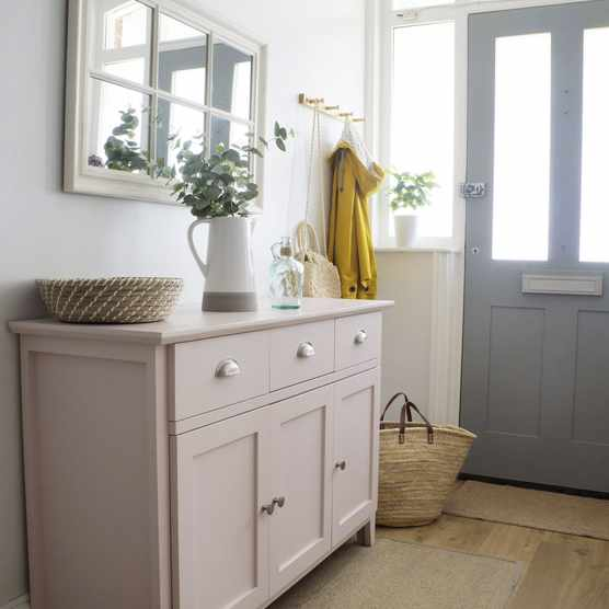 'The staircase and large hallway are what sold the house to me, so I wanted to keep them light and bright to emphasise the space,' says Jade. 'The pink sideboard is one of my favourite pieces of furniture. It cost £30 on Gumtree and then I upcycled it.'