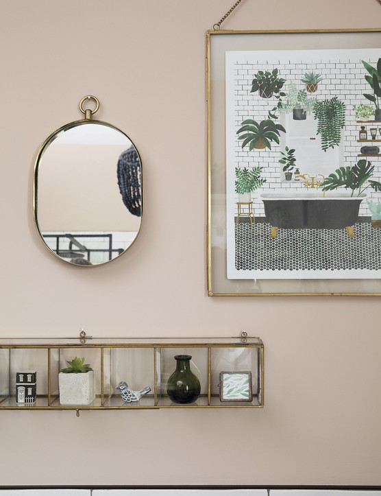 Brass accessories warm up the monochrome scheme. Liz couldn't resist the print, which bears a strong resemblance to her own bathroom