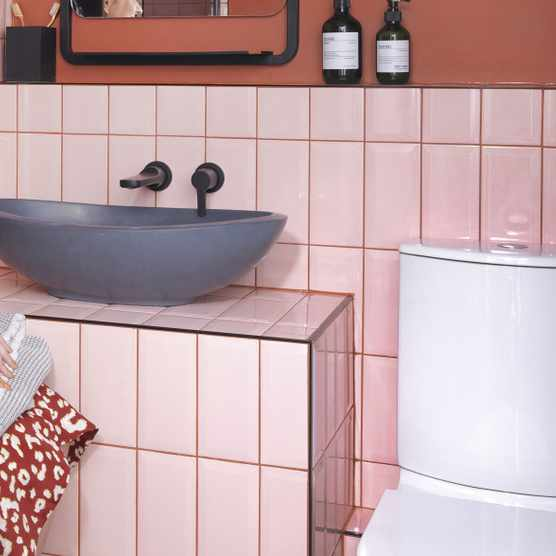 An earthy terracotta colour on the walls works perfectly against the blush metro tiles, which have been laid in a vertical formation rather than the usual brick- style pattern. A rimless loo from B&Q was chosen for its hygienic design, while the sink from BC Designs, mirror from Drench and taps from Crosswater all add a modern, sleek feel to the room. 'I'm so pleased with how the bathroom has turned out,' says Riannon. 'I think the use of colours together makes a change to the standard white tiles and grey grout'