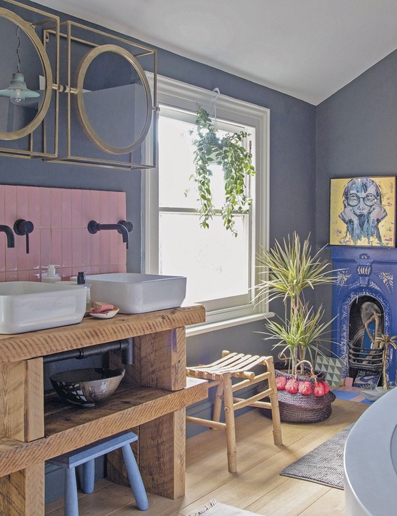 'Our builder made the shelves that our basins sit on using the old loft struts,' says Megan. 'So many people compliment us on them! The gorgeous, glossy pink tiles are from Bert & May,' Megan shares. 'It took hours of internet trawling to find the perfect tile in the right hue, but it was so worth it for the finished effect'