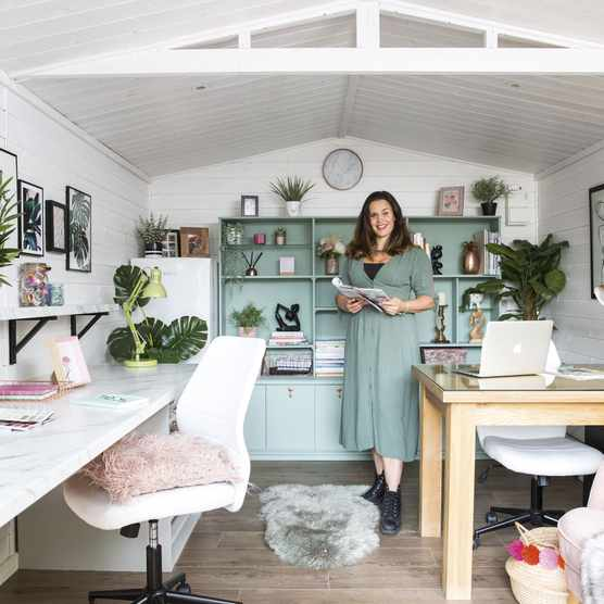 White could be a little cold as a backdrop in an office shed, but Lisa warmed the room up with soft wooden-effect flooring and lots of throws, sheepskin rugs and accessories with hints of pink, copper and green