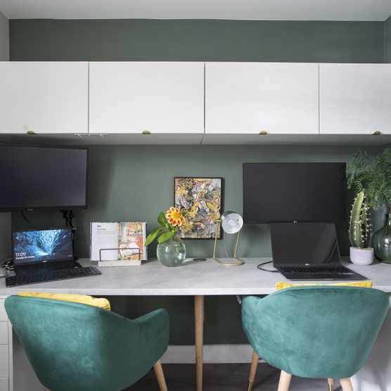 Lydia wanted the desk area to be symmetrical, and comfortable for both her and Peter to use at the same time. She chose twin green velvet chairs for their supportive shape and plush look