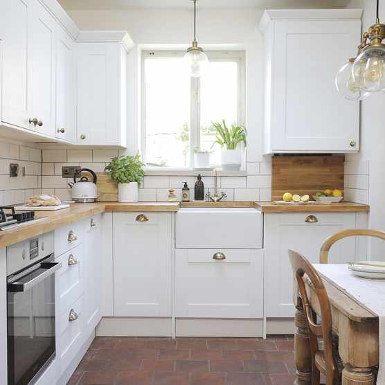 'At first, I wanted a dark blue kitchen, but soon realised it wouldn't work in a small space. I'm really glad I changed my mind as I love the white'